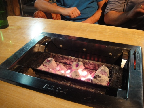 White-hot coals at a table for 4
