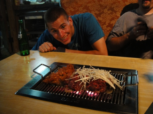 Meat over coals at a table for 4 (we cooked and staff intervened when necessary)